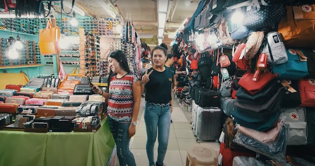 two girls posing for camera in greenhills market