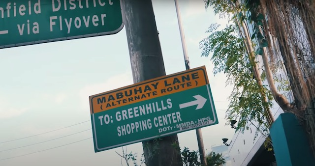 sign pointing to greenhills shopping center