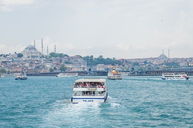 water taxi ferry istanbul on water with mosque in background