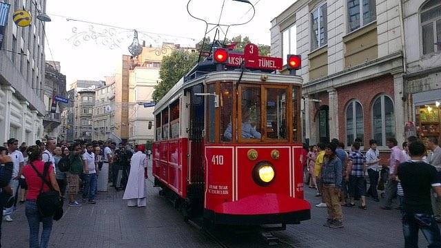 people boarding a tram in taksim square istanbul