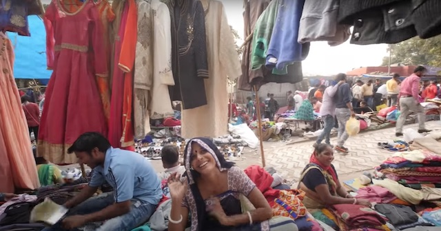 woman selling clothes at thieves market new delhi