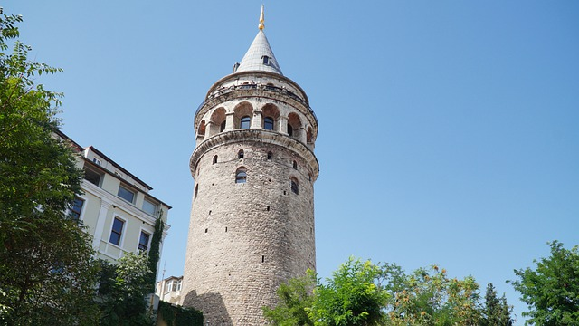 looking up at people at the top of galata tower looking out over istanbul turkey