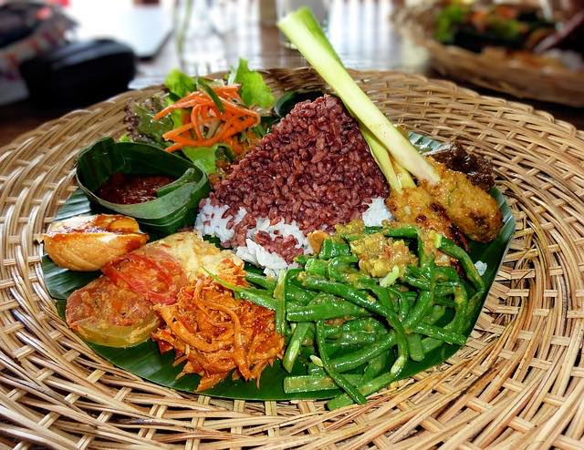 indonesian food in bali includes rice and a variety of spices and vegetables