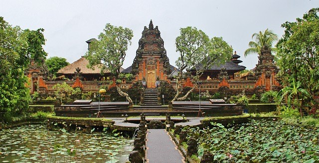 view of famous hindu temple in ubud bali with bridge and water lillies