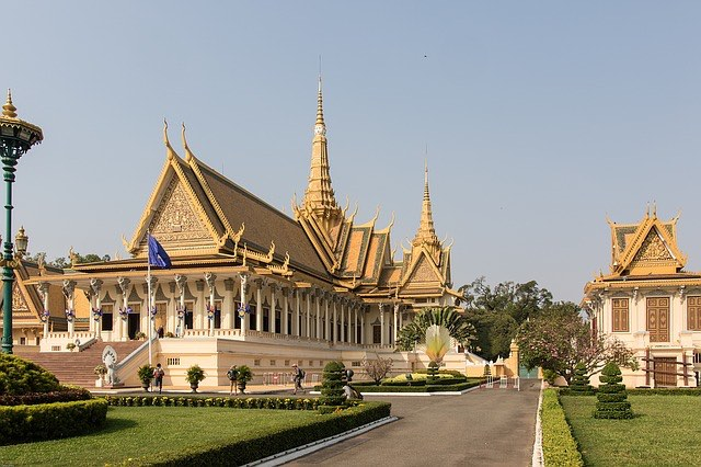 view of the royal palace in phnom penh cambodia with ornate gold decorations and spires