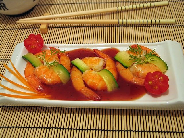 plate of cantonese food with shrimp, cucumbers and sauces