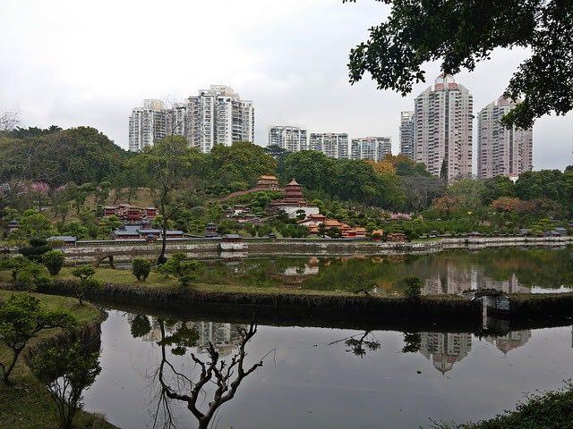 Shenzhen folk village on coast with big city in background