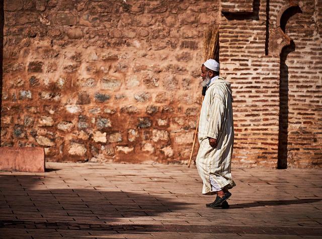 muslim man walking in marrakesh morocco